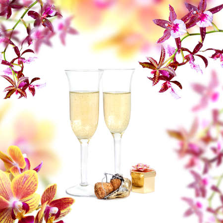 Pair of champagne flutes, cork and gift box on orchid background photo