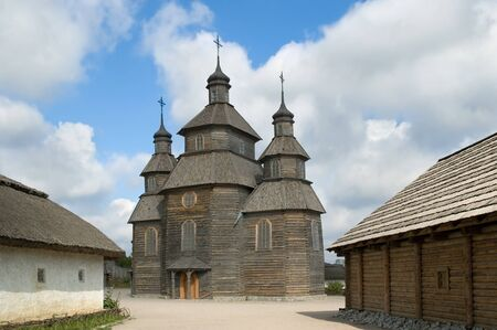 Wooden church in old cossack village in Zaporoche, on Hortitsa island, Ukraine. photo