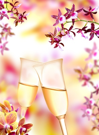 Pair of champagne flutes on orchid background photo