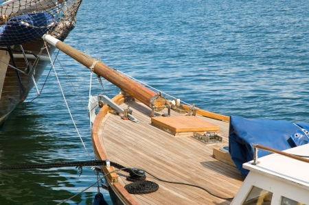 ship deck: Old wooden tall yacht docked in a sea port Stock Photo