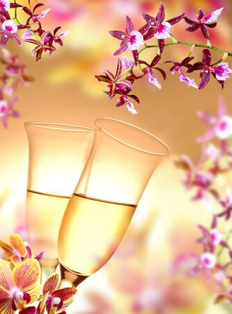Champagne flutes on orchid background photo