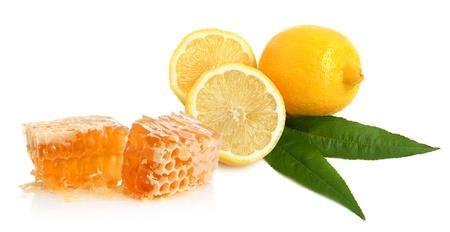 Lemon and honey on white background Imagens
