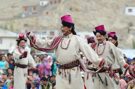 folk heritage: LEH, LADAKH, INDIA - SEPTEMBER 08, 2012: Artists in traditional tibetan costumes performing folk dance. Last day of Annual Festival of Ladakh Heritage in Leh, India. September 08, 2012. Editorial