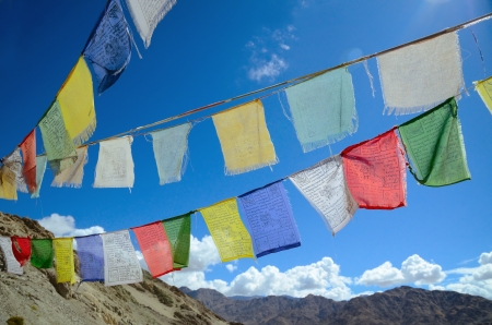 ladakh: Close up of buddhist prayer flags on a sky background in Himalayas