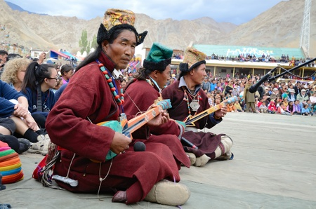 LEH, LADAKH, INDIA - SEPTEMBER 08, 2012: Musicians in tibetan costumes playing on traditional folk instruments. Last day of Annual Festival of Ladakh Heritage in Leh, India. September 08, 2012.