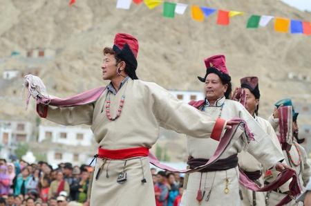 folk heritage: LEH, LADAKH, INDIA - SEPTEMBER 08, 2012: Artists in historical tibetan costumes performing folk dance. Last day of Annual Festival of Ladakh Heritage in Leh, India. September 08, 2012. Editorial