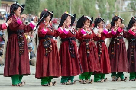 folk heritage: LEH, LADAKH, INDIA - SEPTEMBER 08, 2012: Artist in traditional tibetan costumes performing folk dance. Annual Festival of Ladakh Heritage in Leh, India. September 08, 2012. Editorial