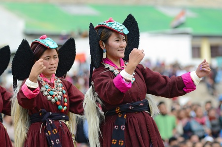 LEH, LADAKH, INDIA - SEPTEMBER 08, 2012: Artist in traditional tibetan costumes performing folk dance. Last day of Annual Festival of Ladakh Heritage in Leh, India. September 08, 2012.