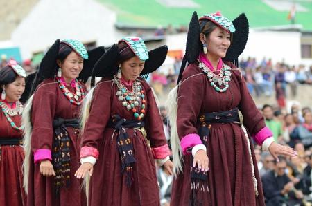 folk heritage: LEH, LADAKH, INDIA - SEPTEMBER 08, 2012: Artist in traditional tibetan costumes performing folk dance. Last day of Annual Festival of Ladakh Heritage in Leh, India. September 08, 2012.