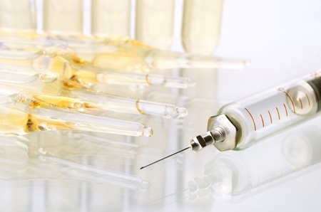 morphine: Vintage syringe and glass vials on white background