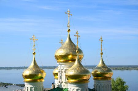 The golden domes of the Church of St John the Baptist in Nizhny Novgorod, Russia and Volga river. Church was built in the 15th century. photo