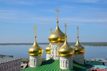 gorky: The golden domes of the Church of St John the Baptist in Nizhny Novgorod, Russia and Volga river. Church was built in the 15th century.