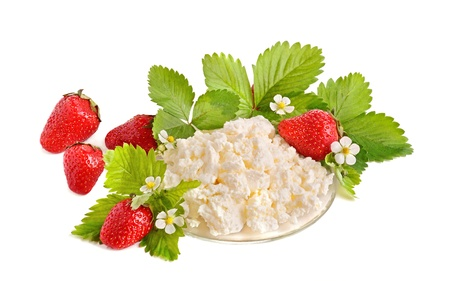 Strawberries with green leaves and cottage cheese on white background photo