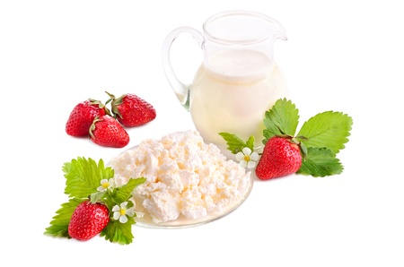 Ripe strawberries, milk and cottage cheese on white background photo