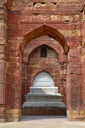 quitab: Red arch of the ornate tomb in archeaological complex Quitab Minar in Delhi, India
