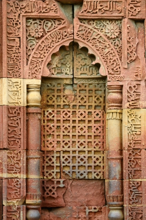 Window arch of the ornate tomb in archeaological complex Quitab Minar in Delhi, India