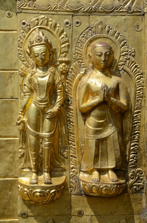 Golden Buddha figures  from Swayambhunath Stupa or Monkey Temple in Kathmandu Valley, Nepal photo
