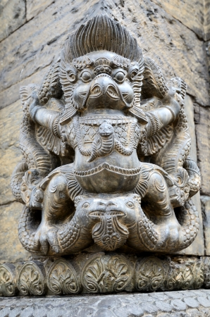 Detail of ancient Hindu sandstone carving monument in India photo