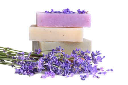 Bars of handmade soaps and lavender flowers on white background photo