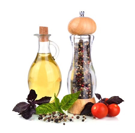 cooking oil: Olive oil with pepper mill tomato and basil leaves on a white background Stock Photo