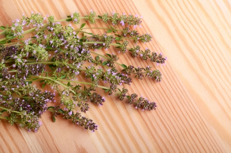 Bunch of thyme flowers on a wood table background photo