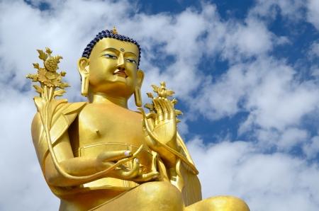 ladakh: Golden Maitreya Buddha statue on blue sky background in Likir Gompa in Ladakh, India. Likir Monastery was established in 1065.