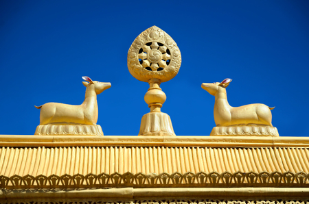 Wheel of Dharma and golden deers on a top of Tibetan monastery gates in India, Ladakh. photo