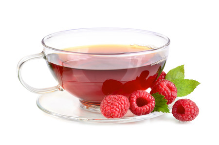 Cup of raspberry tea with fresh berries on white background