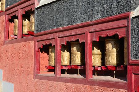 Buddhist prayer wheels at Thiksey Gompa in India, Ladakh. photo