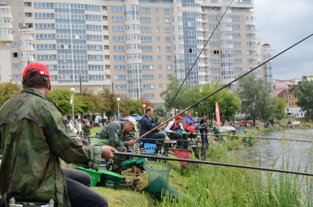 svisloch: MINSK, BELARUS - JUNE 29, 2013: Annual fishing competition Rutilus Cup in the center of Minsk on the Svisloch river. June 29, 2013. Editorial