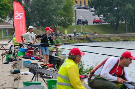 svisloch: MINSK, BELARUS - JUNE 29, 2013: Annual fishing competition RS Cup. The contest takes place yearly, on the last weekend of June, in the center of Minsk, on the Svisloch river. Its a proffesional fishing contest, in which sportsmen from Belarus and Russi