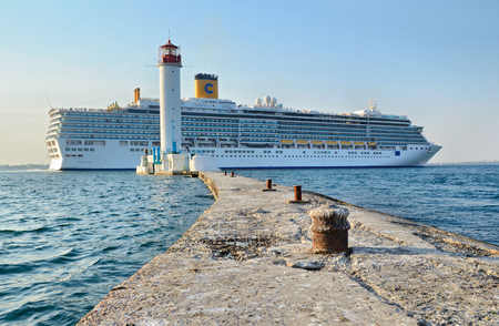 deliziosa: Odessa, Ukraine, August 23, 2013. Cruise ship Costa Deliziosa sailing from Odessa sea port. Vorontsovsky lighthouse on foreground. Editorial