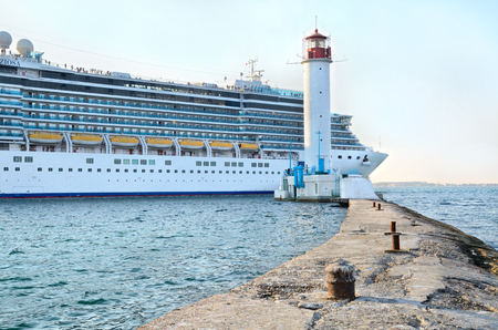 Odessa, Ukraine, August 23, 2013. Cruise ship Costa Deliziosa sailing from Odessa sea port. Vorontsovsky lighthouse on foreground. Editorial