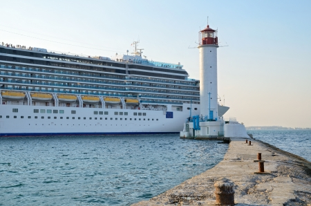 Odessa, Ukraine, August 23, 2013. Cruise ship Costa Deliziosa sailing from Odessa sea port and Vorontsovsky lighthouse.