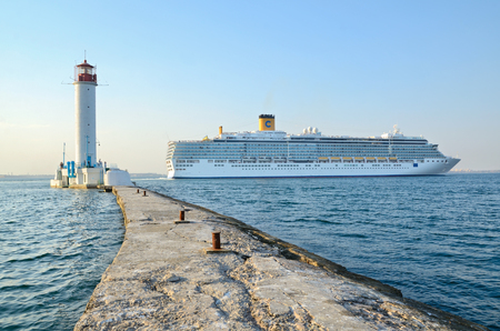 deliziosa: Odessa, Ukraine, August 23, 2013. Cruise ship Costa Deliziosa sailing from Odessa sea port and Vorontsovsky lighthouse.