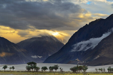valley of the temples: Sunset over Himalayas mountains in Nubra valley and Buddhist monastery Diskit Gompa, Ladakh, India