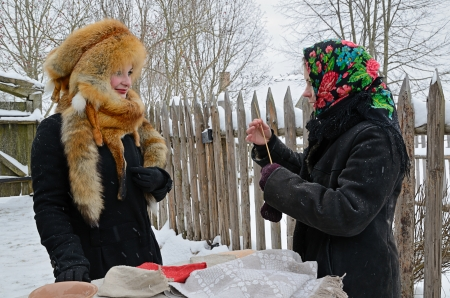 divination: Minsk, Belarus - January 18, 2014: Traditional divination during the Old Slavonic holiday Kalyada in Strochitsy in Belarusian State Museum of Folk Architecture and Rural Lifestyle