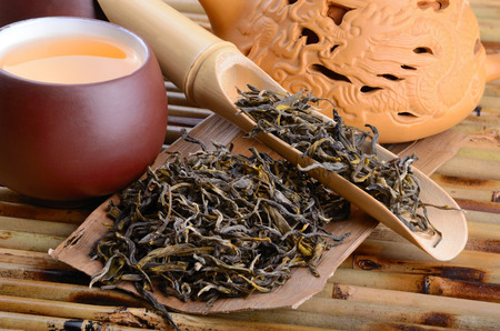 Aromatic oolong tea from China on bamboo mat background Stock Photo