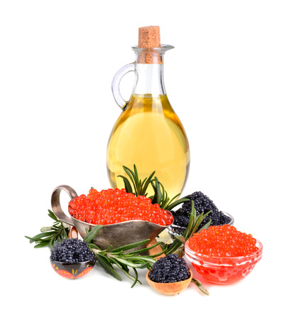 Black and red caviar with olive oil and rosemary on a white background photo