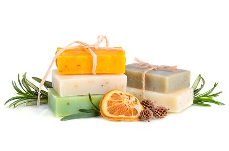 rosemary flower: Handmade herbal soaps with rosemary on white