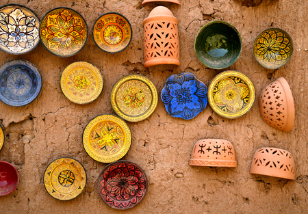 faience: Colorful faience pottery dishes in a pottery workshop in Morocco Stock Photo