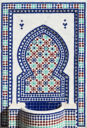 mosaic art: Colorful mosaic on typical moroccan fountain in medina of Meknes, Morocco.