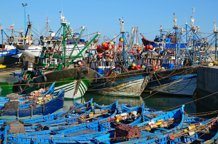 east africa: Essaouira port with blue boats for shark fishing and big ships at the morning. Morocco, the Atlantic coast, North Africa.