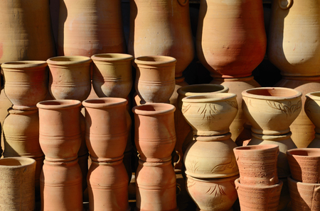 Handmade moroccan clay dishware in a pottery shop in Marrakesh photo