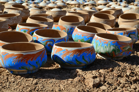 Handmade moroccan clay dishware in a pottery factory in Marrakesh photo