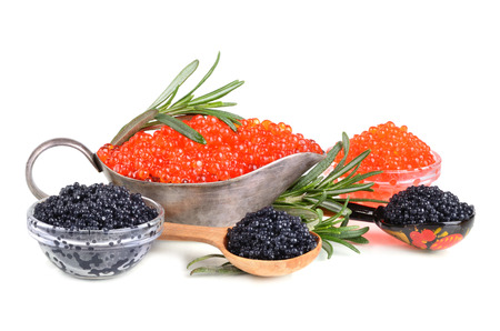 Black and red caviar on a white background photo