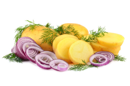 Sliced potatoes, red onion and green dill on a white background photo