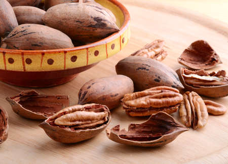 pecan: Pecan nuts close up on a wooden background