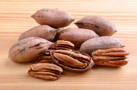 pecan: Close up pecan nuts on a wooden background