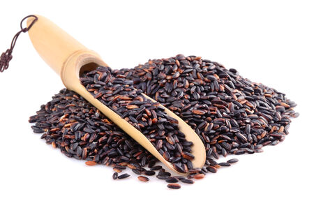 Pile of black wild rice with bamboo spoon isolated on white background photo